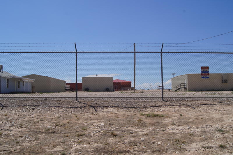 Fenceline of the Federal Law Enforcement Training Center, where hundreds of Central American migrants are housed after being apprehended at the border