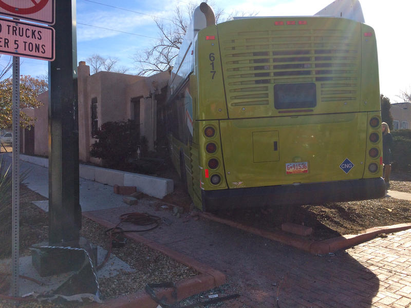 A city bus crashed into a house on the SE corner of Girard and Coal in Albuquerque, N.M.