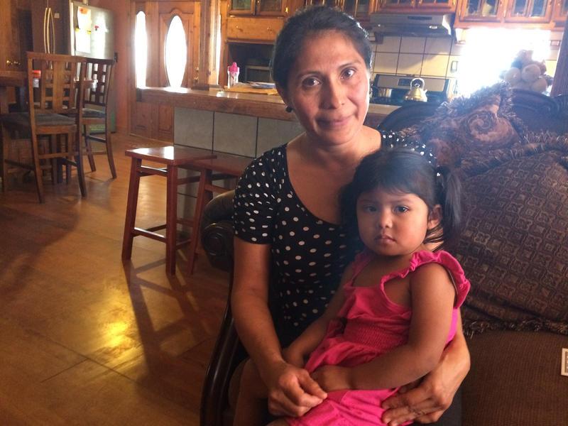 Mireya Cervantes with her daughter Miranda inside their home on Pajarito Mesa