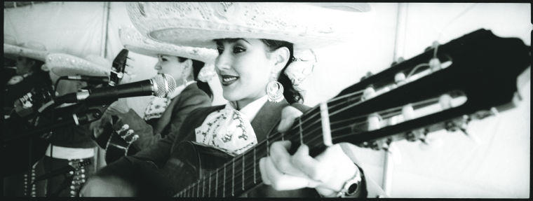 Miguel A. Gandert: Mujeres y guitarras/Women and Guitars, from Hotel Mariachi, University of New Mexico Press