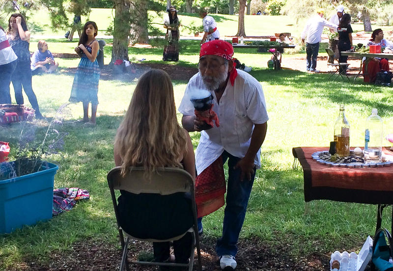 A curandero does a treatment at the University of New Mexico on Wednesday, July 22.