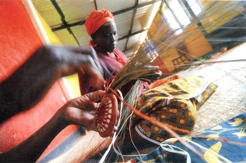 Women weaving baskets for Gahaya Links
