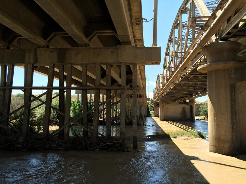 The San Juan River flows under the bridge in Shiprock.