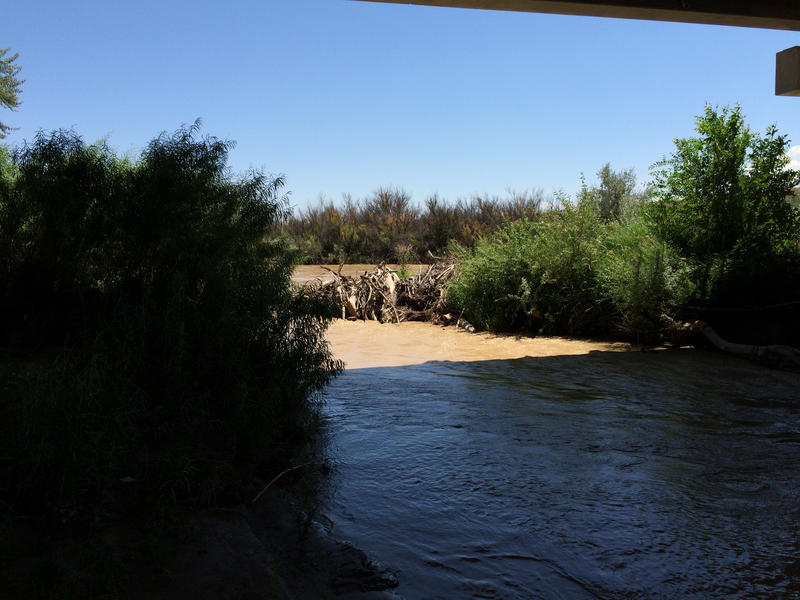 The San Juan River flows under a bridge in Shiprock.