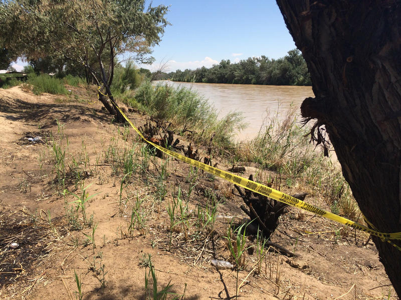 Caution tape strung tree-to-tree on the San Juan riverbank in Shiprock