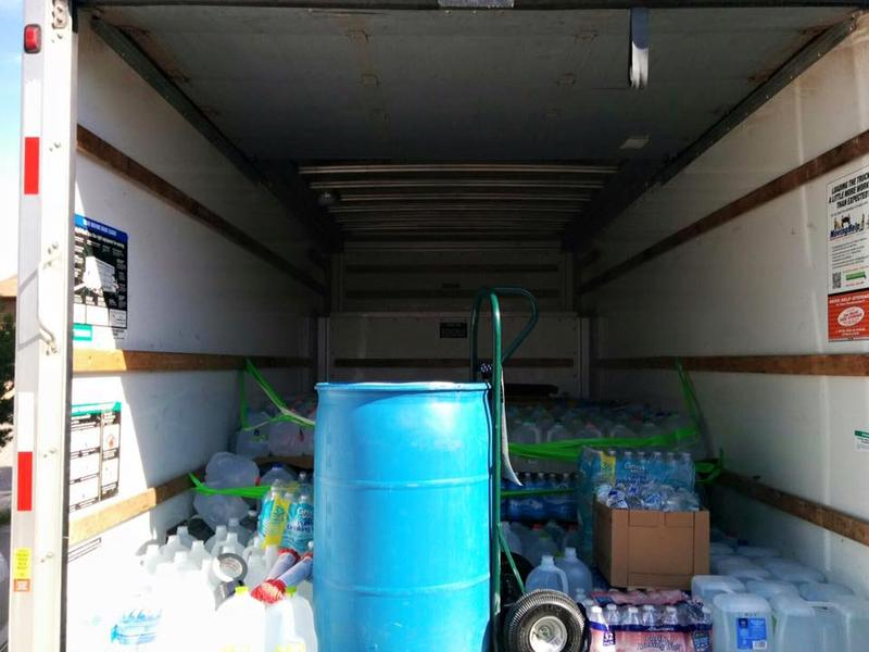 Water donations loaded into the back of a truck destined for Shiprock.