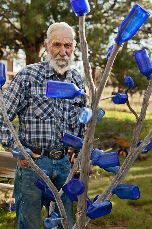 Pop McKee in his front yard
