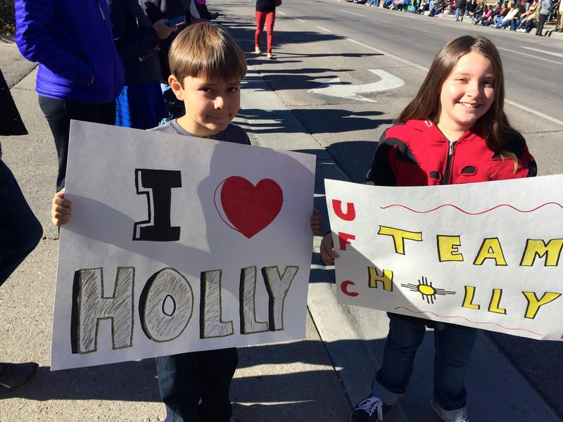 Thousands of people poured out onto the streets of Albuquerque Sunday to greet Holm.