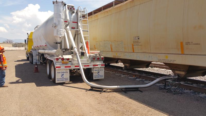 Workers transload industrial materials at NMT