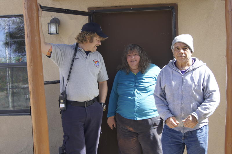 Firefighter and EMT Rollin Jones at a home visit to Joaquin and Carol Garcia's house