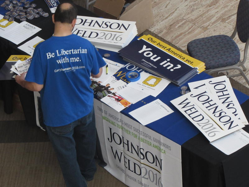 Gary Johnson campaign supplies cover this table at a rally in Albuquerque on Saturday