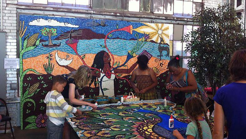 The community works on seeding the Peacock Mural.
