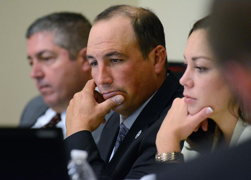 Former APD officer Keith Sandy (center) with his attorneys Sam Bregman and Monnica Garcia