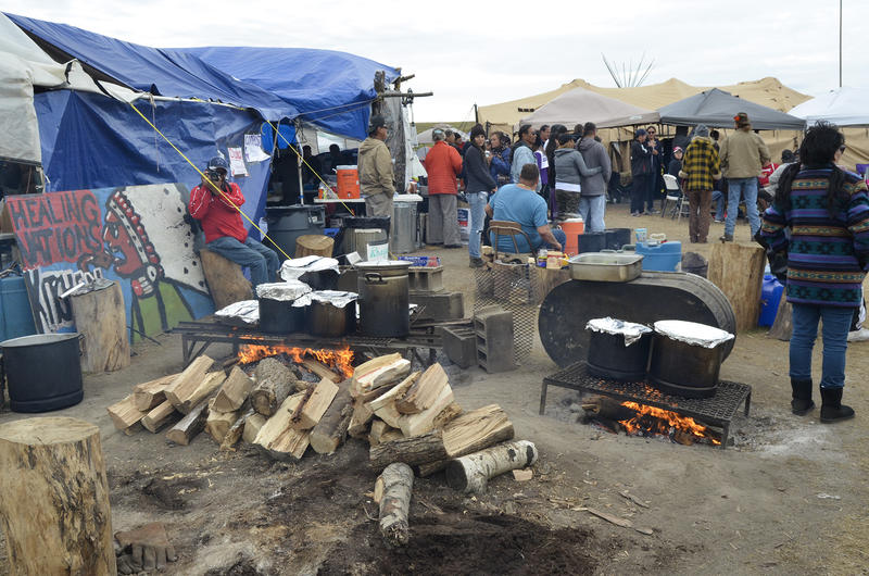 Meals cook over a fire to feed hundreds of people at a camp near the Standing Rock Sioux Reservation in North Dakota.