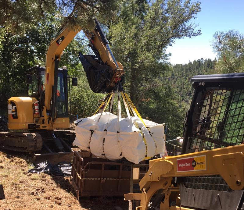 The plutonium levels in the soil are low, but cleaning it up still requires strict oversight. Polluted dirt is loaded into double-lined bags, screened for radioactivity levels, then hauled away to a secure site on DOE property