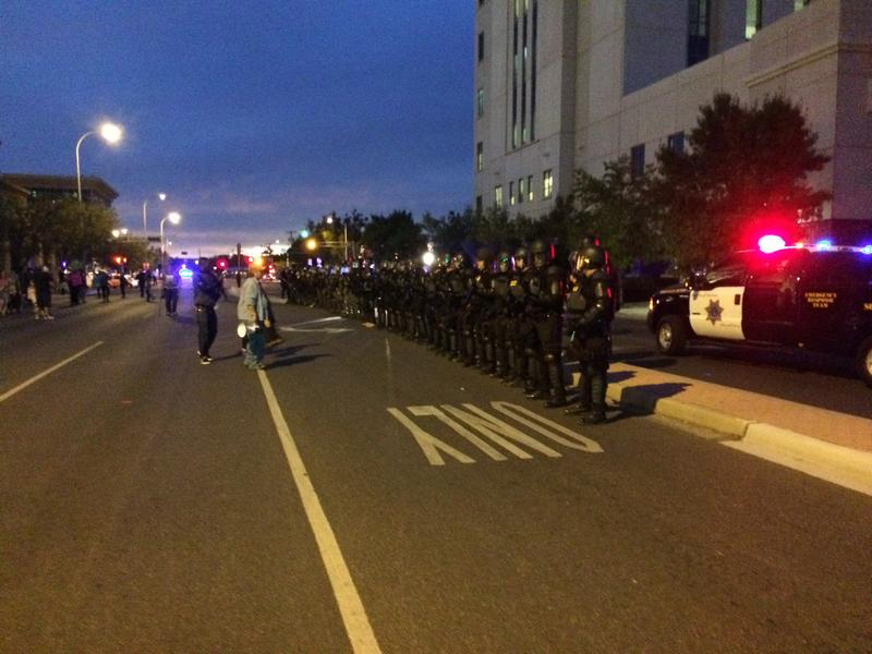 Officers in riot gear at Fourth Street and Lomas in Albuquerque on October 12, 2016
