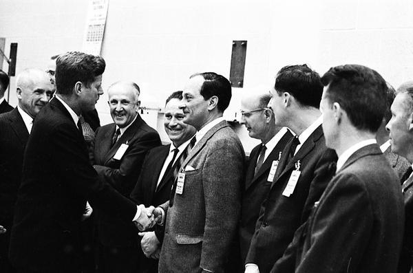 President John F. Kennedy talks to a team of scientists working at Los Alamos National Laboratory in 1962.