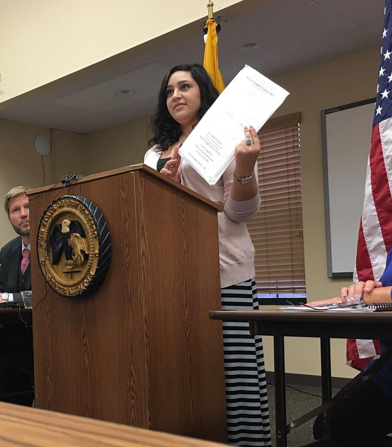 Victim Advocate Stephanie holds a sexual assault evidence kit at State Auditor's Press Conference