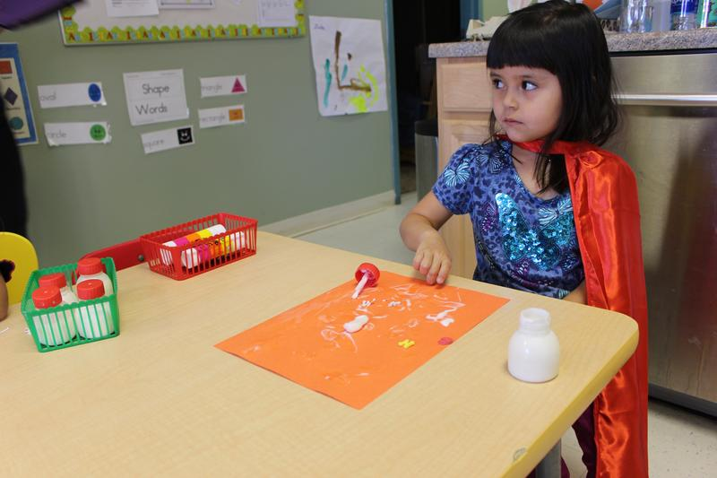 Alexis plays arts and crafts at Conjunto preschool in Española where the program is tailored for students who have experienced drug-related trauma.