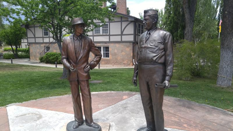 Statue of scientist Robert J. Oppenheimer and Gen. Leslie Groves, who together led the Manhattan Project, near Fuller Lodge in Los Alamos
