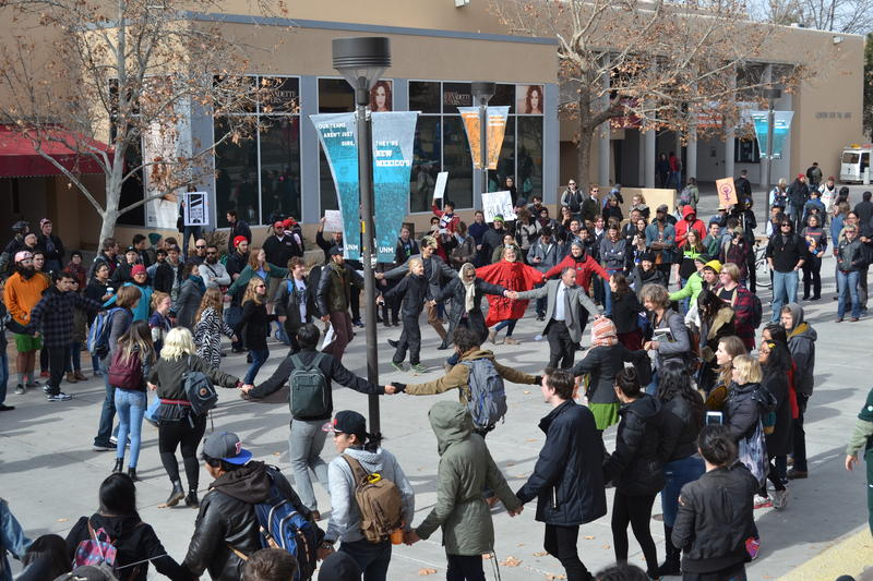 Native students pulled protesters together for a dance and a moment of unity at the end of the demonstration.