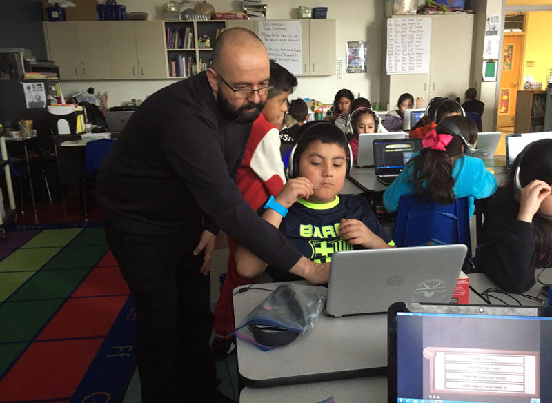 "Bernalillo teacher Michael Chavez troubleshoots while his fourth graders practice the ""Imagine Learning"" test."