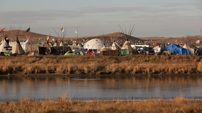 Late afternoon light illuminates a portion of an encampment called the Oceti Sakowin Camp near from the Standing Rock Sioux Reservation in southcentral North Dakota on Nov. 19, 2016.