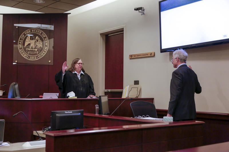 Mark Zusman is sworn in on Friday, March 31, by District Court Judge Sarah Singleton.