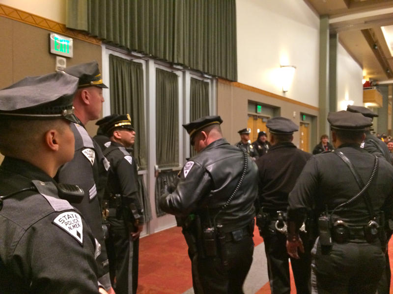 State police officers look on as demonstrators outside bang on these doors on Jan. 27, 2017, at UNM.
