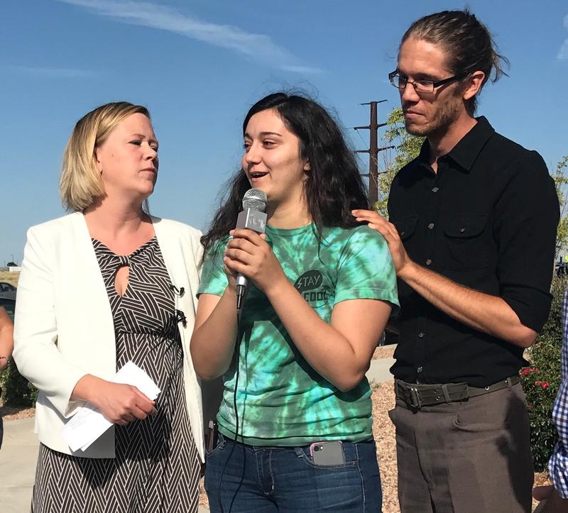 Attorney Rebecca Kitson and Justin Remer-Thamert with the NM Faith Coalition for Immigrant Justice stand with Courtney Albumohammed, daughter of Kadhim Albumohammed.