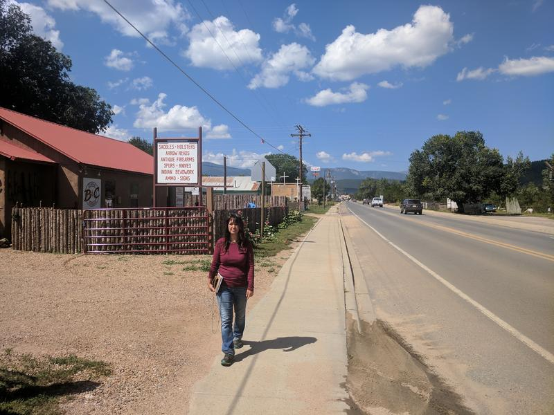 Mora County Commissioner Paula Garcia walks to the county building in the town of Mora.