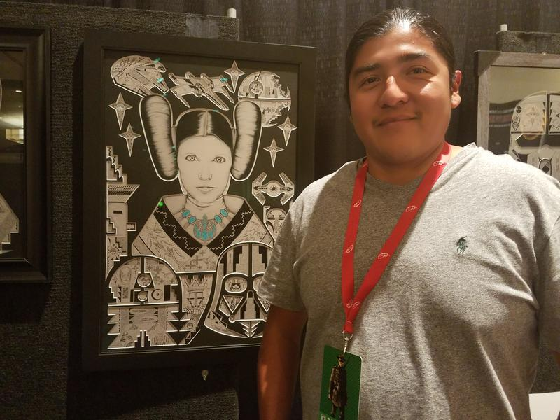 Jemez Pueblo artist Michael Toya with his Princess Leia portrait