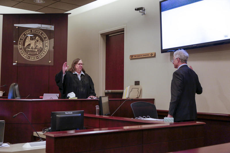 District Court Judge Sarah Singleton in March swears in Mark Zusman, one of the people who owns the Santa Fe Reporter.