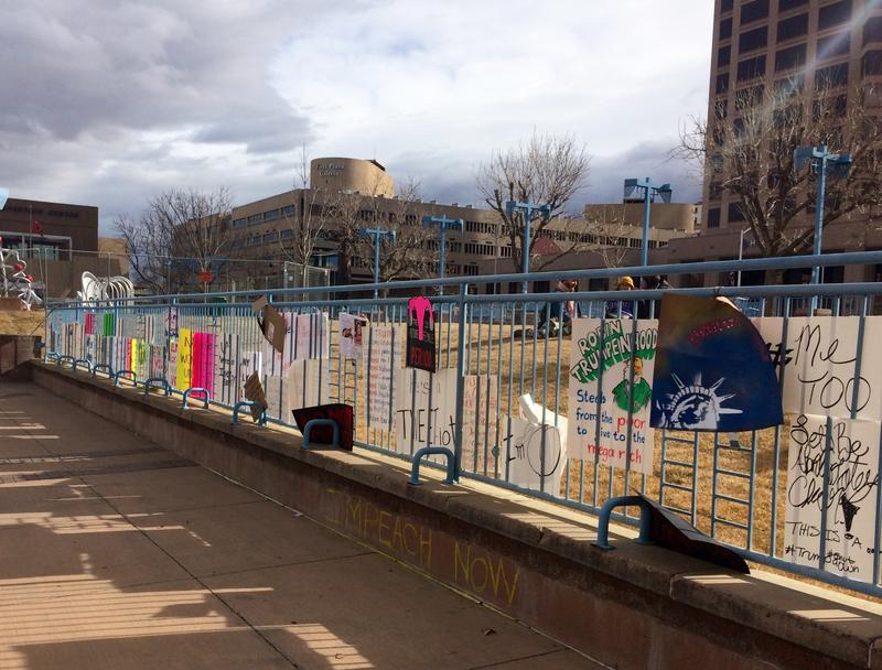 Some demonstrators tucked their signs into fencing on Civic Plaza as they left.