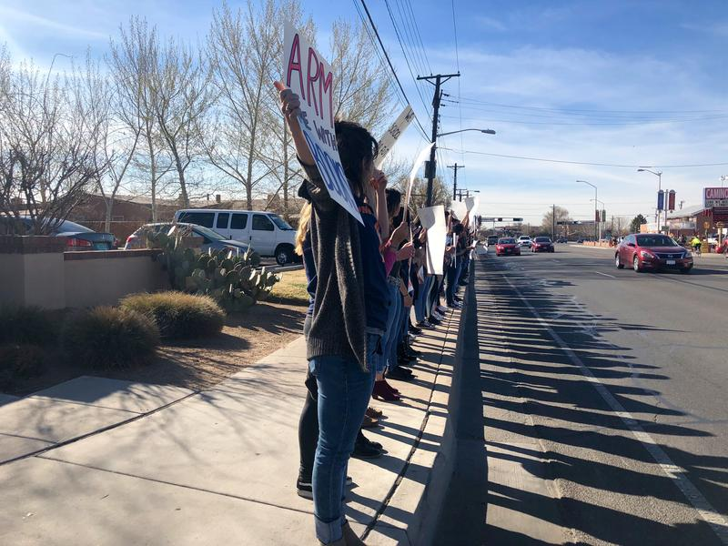 Tierra Adentro students hold signs and stand in silence along Rio Grande Boulevard on Wednesday, March 14, 2018.