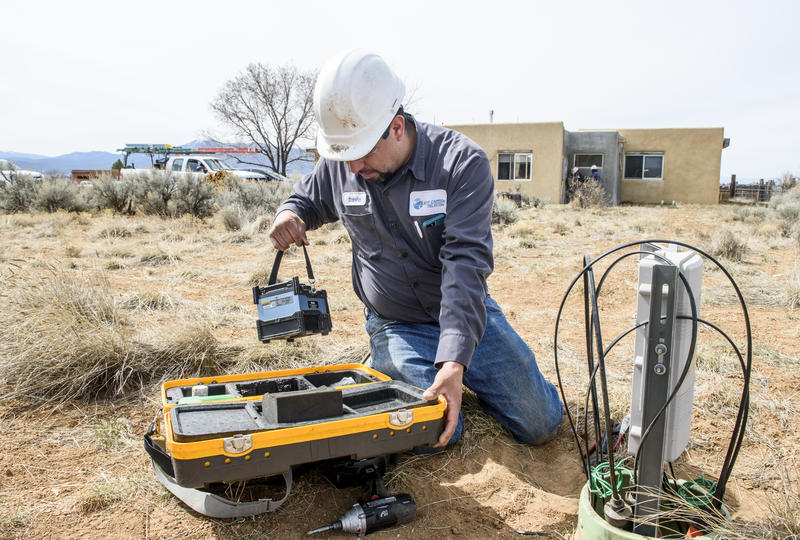 David Trujillo demonstrates how a fiber optic splicer works at a home in Taos, on March 26, 2018. Kit Carson Electric Cooperative was one of the first electric coops in the U.S. to offer high-speed Internet service, and now serves roughly 6,300 customers.