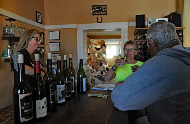 Barb Payla of Minnesota samples wine at the Black Range Vineyards tasting room in Hillsboro with her husband George on a Monday afternoon in March. At left is Nicki O'Dell, the winery's owner.