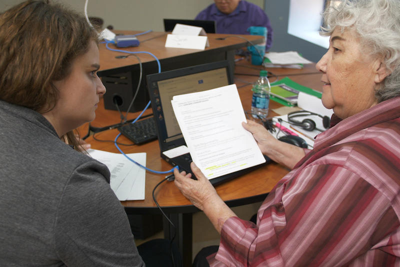 SoloWorks center director Shelly Fausett, left, and program participant Sarah Pena discuss job opportunities at the SoloWorks center in Grants, New Mexico, on March 13, 2018.