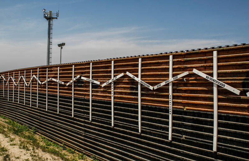 Mexico-United States fence at the border of Tijuana, Mexico and San Diego, USA. The crosses stand for migrants who died in the crossing.
