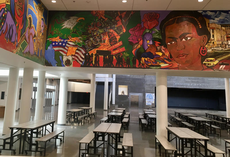 A mural painted by Francisco Febre depicts a timeline of Chicano/a history and culture on the walls of Albuquerque High School.