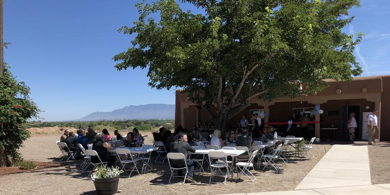 Guests sit outside the new wing at the Serenity Mesa Youth Recovery Center during an open house