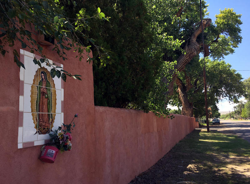 Flowers adorn the wall of a property in Albuquerque's South Valley where the Servants of the Paraclete used to run a treatment center for problem priests. The property is now a family compound.