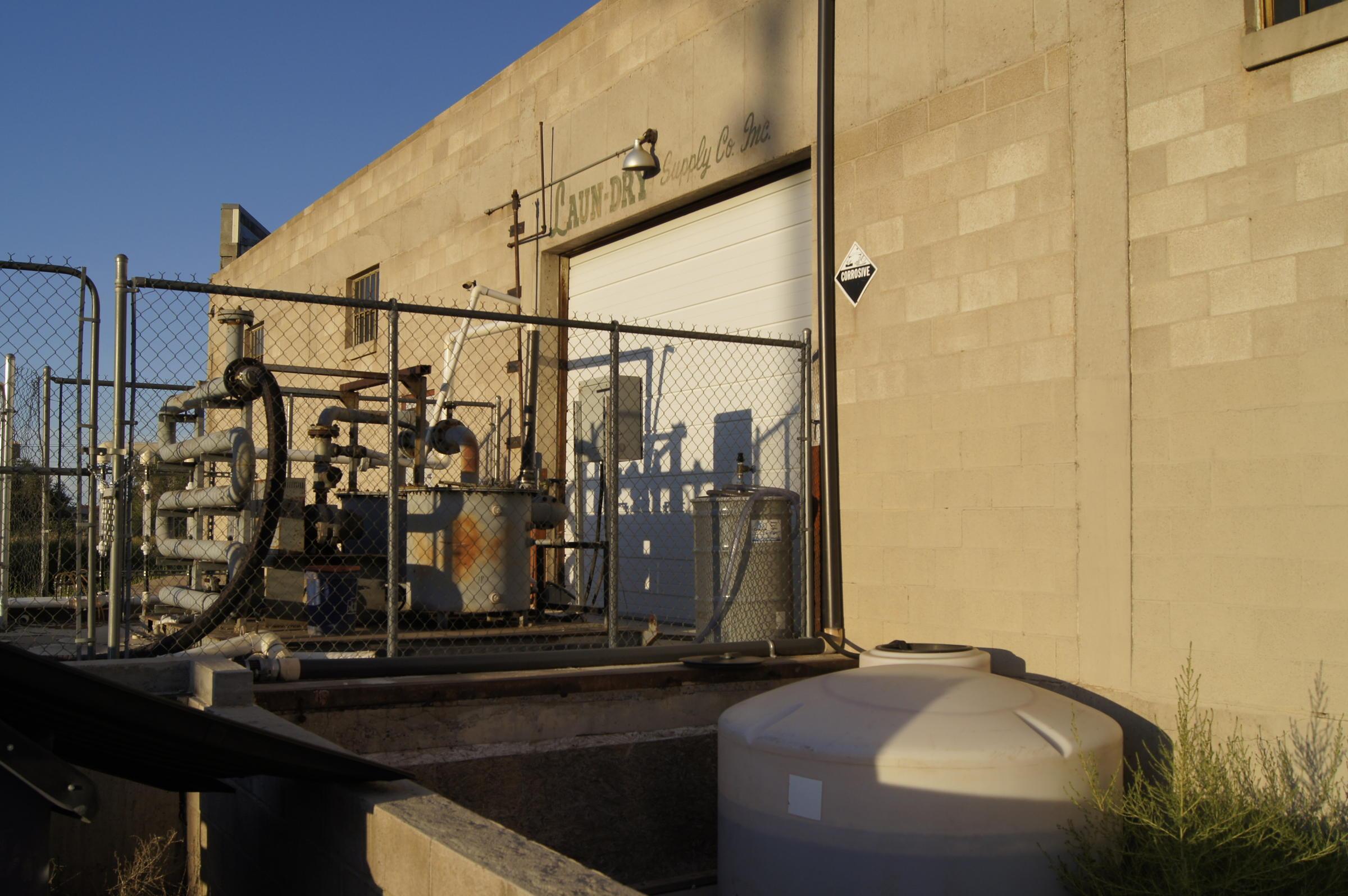 Soil vapor extraction unit sits on laun dry s rear loading dock