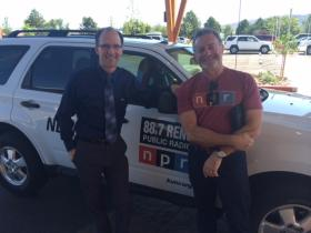 KUNR's David Stipech greets NPR CEO Jarl Mohn upon his airport arrival in Reno July 24, 2014.