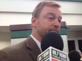 Senator Dean Heller speaks to reporters Monday after meeting with officials from Granite Construction Supply in Sparks.