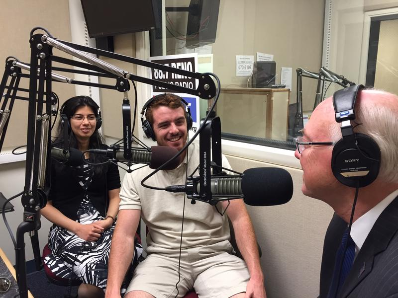 Spring 2015 graduates Ruchi Gakhar (left) and Jake Pereira visit with University of Nevada, Reno President Marc Johnson on KUNR's Beyond the Headlines. 5-1-15