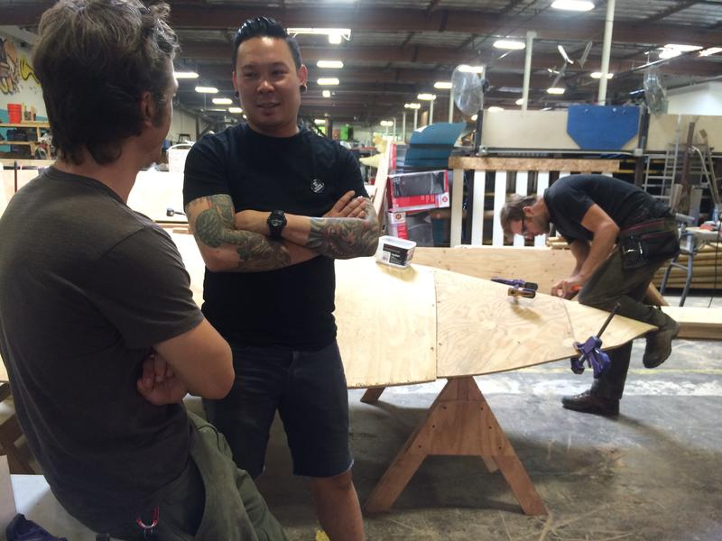 Charlie Nguyen, art director, talks to a crew member at The Generator arts space in Sparks.
