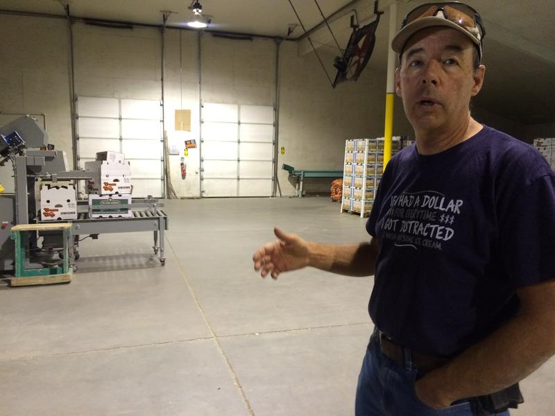 John Snyder of Snyder Livestock Company shows how onions are packaged at his processing facility in Yerington.