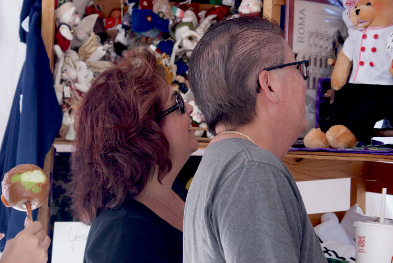 A couple admires some of the merchandise being sold at the festival.