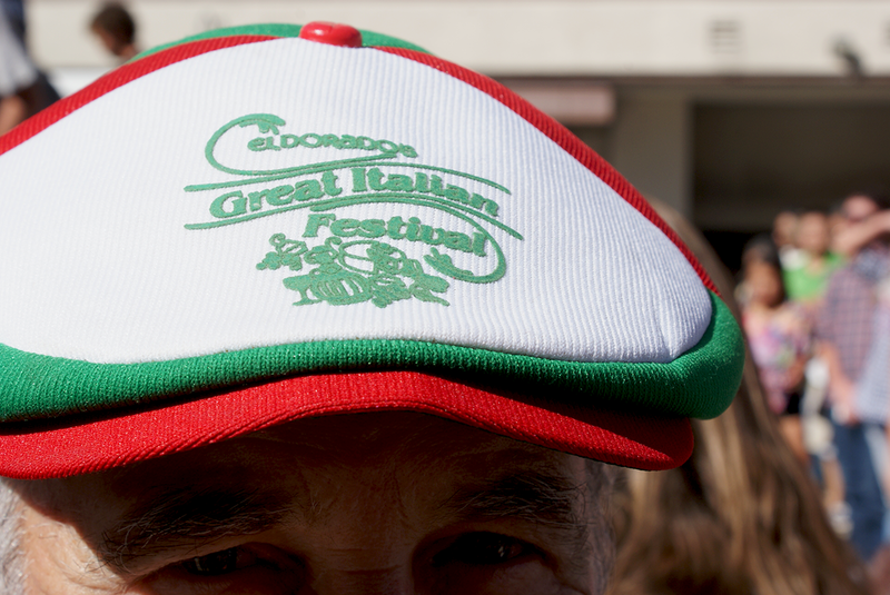 A visitor from Chicago donning the signature Great Italian Festival hat before getting ready to smash some grapes. Oct. 11, 2015.